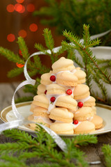 small Christmas tree of homemade cookies with fir branches