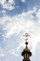 The cross of the orthodox Christian church against the cloudy sk