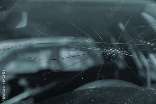 Broken glass on the car - 69429456