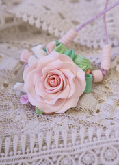 Fashion studio shot of a floral rose necklace (jewelery made of