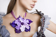 Fashion studio shot of beautiful woman with a big floral necklac