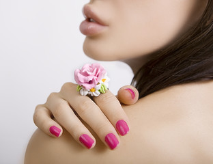 Fashion studio shot of beautiful woman with a floral ring (jewel
