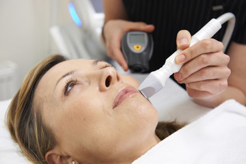 Beautician Carrying Out Ultrasound Skin Rejuvenation Treatment