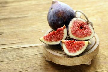 fresh ripe purple figs on wooden board