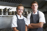 Fototapety Portrait Of Chef And Trainee In Kitchen