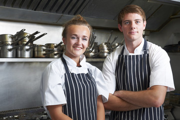 Portrait Of Chef And Trainee In Kitchen