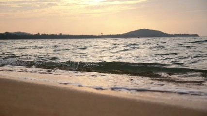 Closeup of Sea Waves on the Beach at Sunset. Slow Motion.