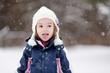 Little girl having fun on winter day
