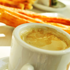 cafe y porras, coffee and thick churros, the typical breakfast i