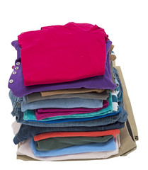 Tall Stack Of Folded Clothing Shot On Angle