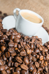 coffee beans and cup of coffee. Selective focus.