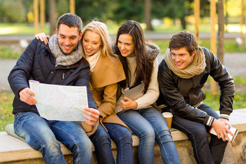 group of friends with map outdoors