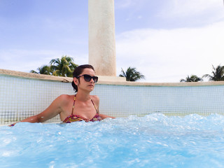 Young girl in a swimming pool with jacuzzi