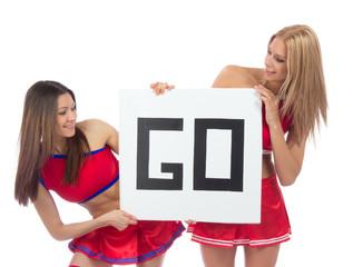 Cheerleader dancer girls from cheerleading team hold sign