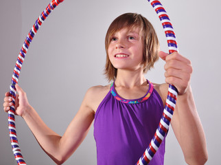 child exercising with a hoop