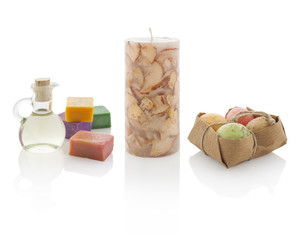 Spa oil in bottles with scented candles and soaps. With PS paths