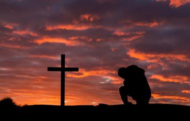 Man In Pray Cross