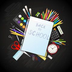 Back to school background with supplies tools on blackboard