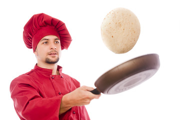 Isolated chef preparing corn pancake
