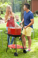 Diverse friends talking on barbecue