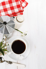 Morning coffee over white wooden background