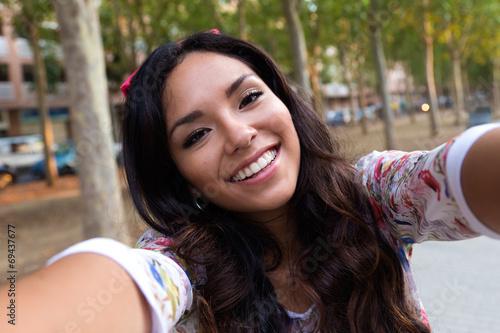 Pretty student girl taking a selfie.