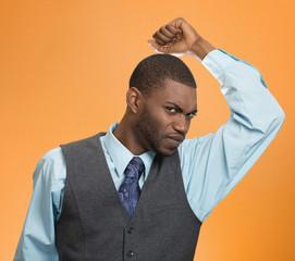 Man, smelling sniffing his armpit, something stinks bad