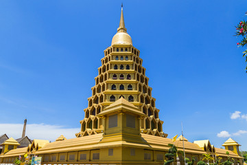 big golden pagoda in thai temple on  blue sky background