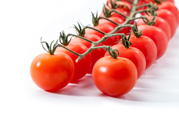 red tomatoes with branch on white background