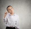 Child thinking, has an idea eureka pouting finger up
