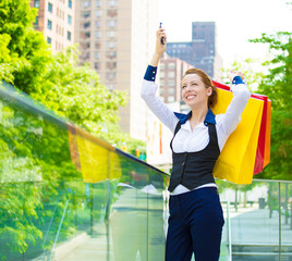 Happy woman holding shopping bags, smiling happy shopper