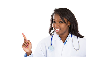 Female doctor pointing at copy space on white background