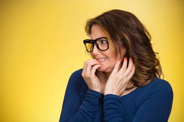 woman biting her fingernails, craving something, anxious