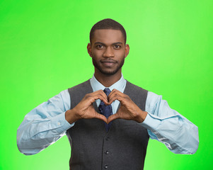 man makes hand shape heart, green background