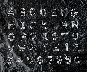 Hand drawn letters font written on wall texture background desig