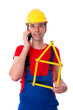 worker with folding yardstick- house is calling