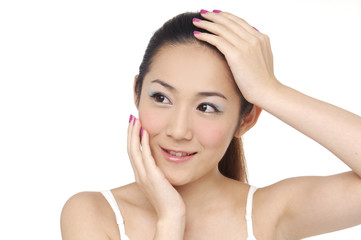 young woman pampering her face by beauty slender fingers