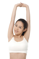 Beautiful happy young woman with her arms in the air.