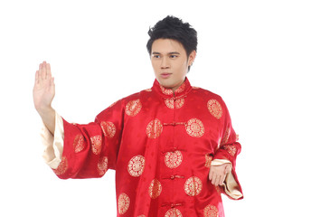 Chinese young man with tradition clothing practicing tai chi