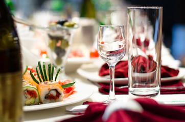 Sushi and glasses on a formal dining table