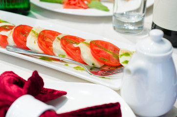 Italian Caprese salad on a dining table