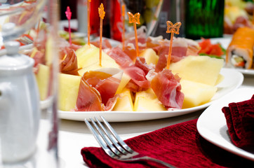 Smoked ham and cheese appetizers on a buffet