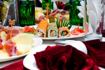 Assorted gourmet sushi rolls on a buffet