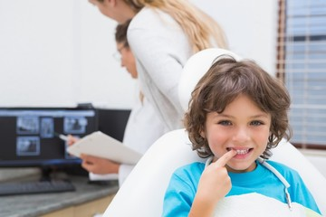 Little boy smiling at camera at dentists