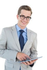 Nerdy businessman using his tablet pc