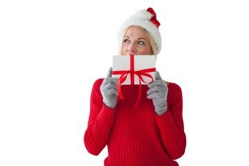 Festive blonde holding a present