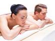 Couple lying on the massage desks.