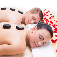 Attractive couple relaxing in spa salon.