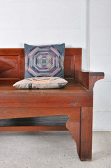 asian style fabric pillow on wooden sofa