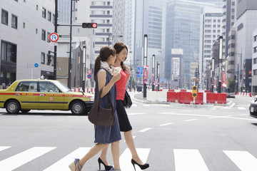 Women across the crosswalk